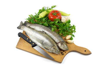 Fresh trout with parsley, garlic, tomato, pepper and knife