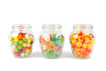 Glass jars filled with different colorful candies