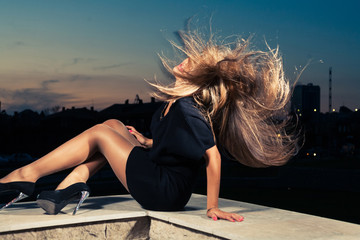 Women with her hair in the air flying by a wind