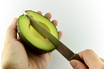 Knife cutting avocado
