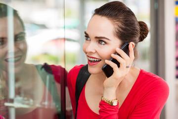 Woman on phone window shopping