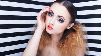 Young attractive woman with professional make up
