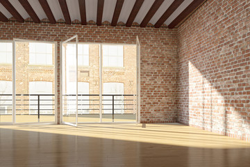 Empty loft with red brick wall