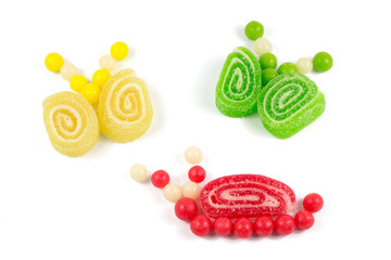 Snail and butterflies made of colorful bonbons and  jelly