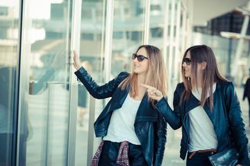 two beautiful young women shopping