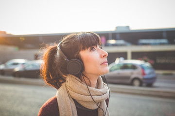 young beautiful hipster woman listening music