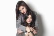 Sisters looking and hugging