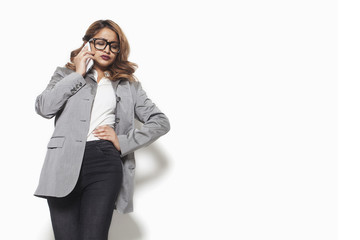 Disappointed businesswoman talking on the phone