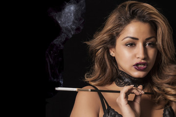 Sexy woman holding cigarette holder