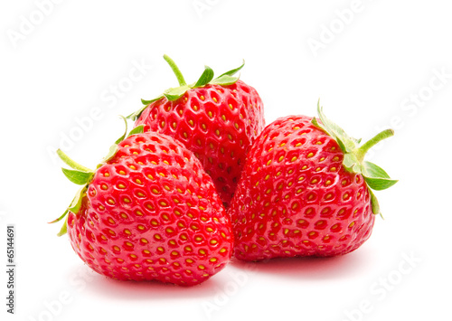 Three perfect red ripe strawberry isolated