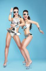 Night Life. Two Glamorous Women Dancers in Fantastic Masks