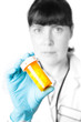 Doctor or pharmacist holding a bottle of pills