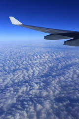 cloud and sky as seen through window of an airplane