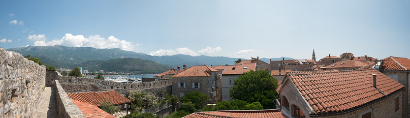 Budva bay behind the tile roofs of old town, Montenegro.