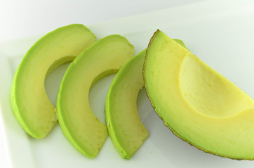 Avocados on white plate