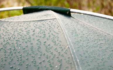 Drops of morning dew on green tent surface