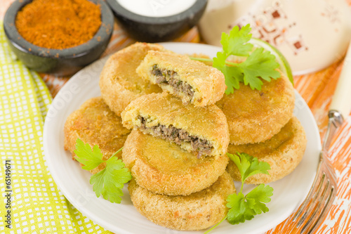 poster of Batata Chap - Middle Eastern potato croquette filled with lamb