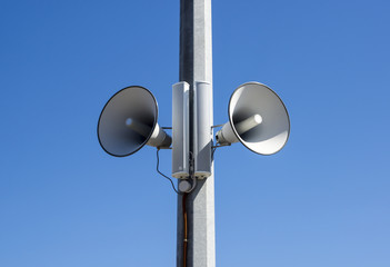 Street speakers in blue sky