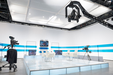 Television studio with jib camera and lights