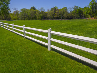 White fence on farm in Spring
