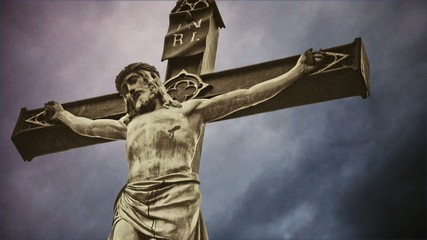 Crucifixion. Christian cross with crucified Jesus Christ statue