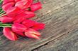 tulips on wooden surface