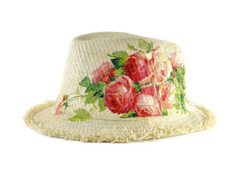 Pretty straw hat decorated with decoupage on white background