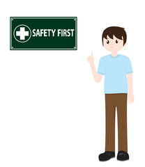 Man pointing at safety first sign