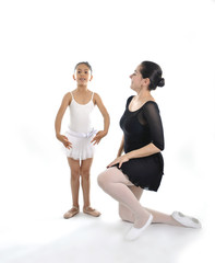 little girl ballerina learning dance lesson with ballet teacher