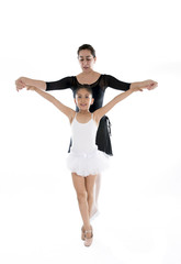 likttle ballerina dancer learning ballet lesson with teacher