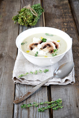 Potato cream soup with mushrooms, thyme and ricotta.