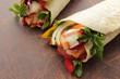 Tortilla wraps with tasty chicken and fresh vegetables
