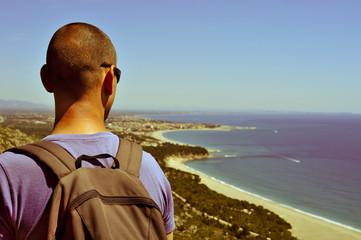 young man looking at the mediterranean sea