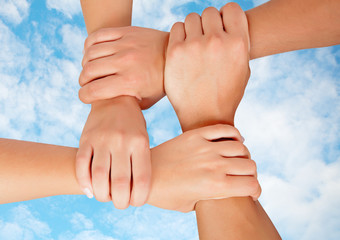 Joined hands in a symbol of cooperation