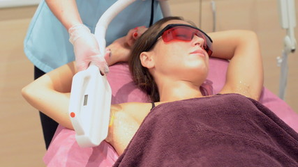Laser hair removal for a young woman. armpit without hair