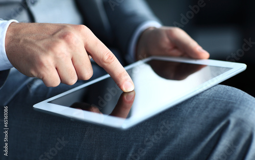 businessman touching screen of a tablet computer.  - 65161086