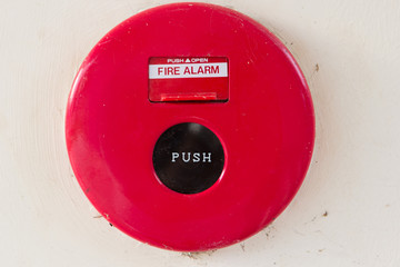 Dirty fire alarm on the wall