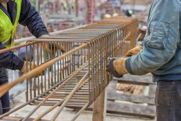 workers hands fixing steel reinforcement bars 2