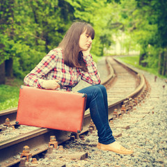 young teenager girl sitting on the rails