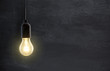canvas print picture - Light bulb lamp on blackboard background with copy space