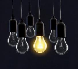 Light bulb lamps on black background