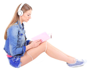 Conceptual image of  audio book.Beautiful girl with book and
