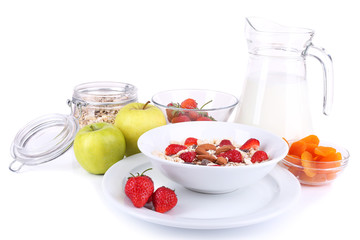 Healthy cereal with milk and fruits isolated on white