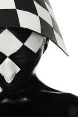 Haif  face with a chessboard on the head