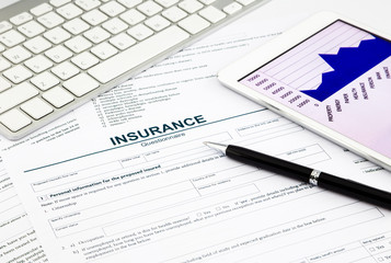 insurance questionnaire and tablet