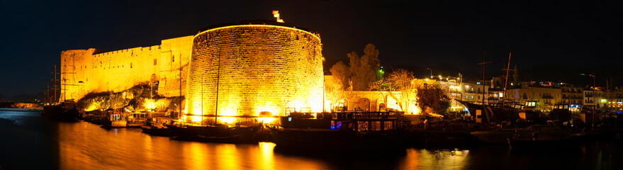 Night panorama of Kyrenia harbour with medieval castle. Cyprus