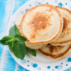 Homemade pancakes with mint leaves, close-up, above view