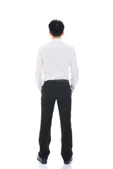 Asian business man from the back - looking at something over a