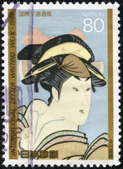 stamp shows painting of a Japanese woman