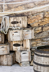 Wooden fishing crates and seine